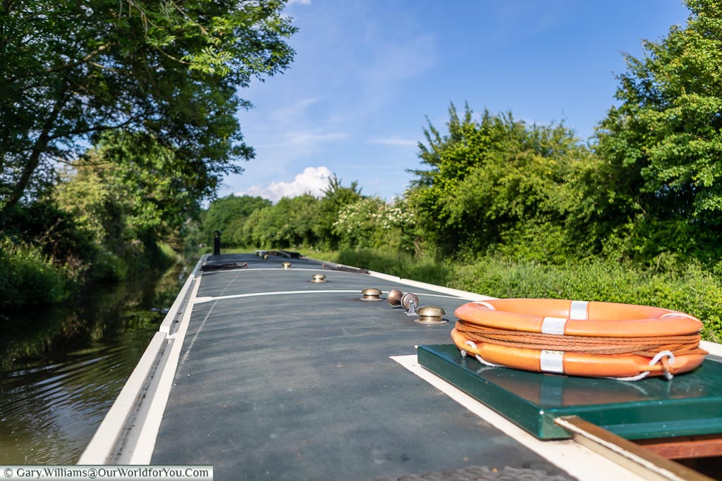 The view along the roof of our Widebeam canal boat with the lifebuoy, one of the many safety features onboard, located on the hatch at the aft end of the boat.