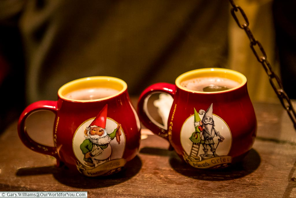 Two of the detailed gluhwein mugs, depicting a different trade, from Cologne's 'Elf Market'.