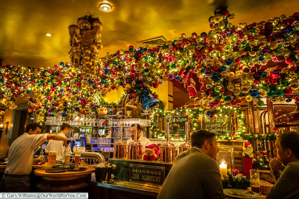The brightly decorated bar of the Brauhaus Joh. Albrecht.  There's hundreds of coloured baubles.