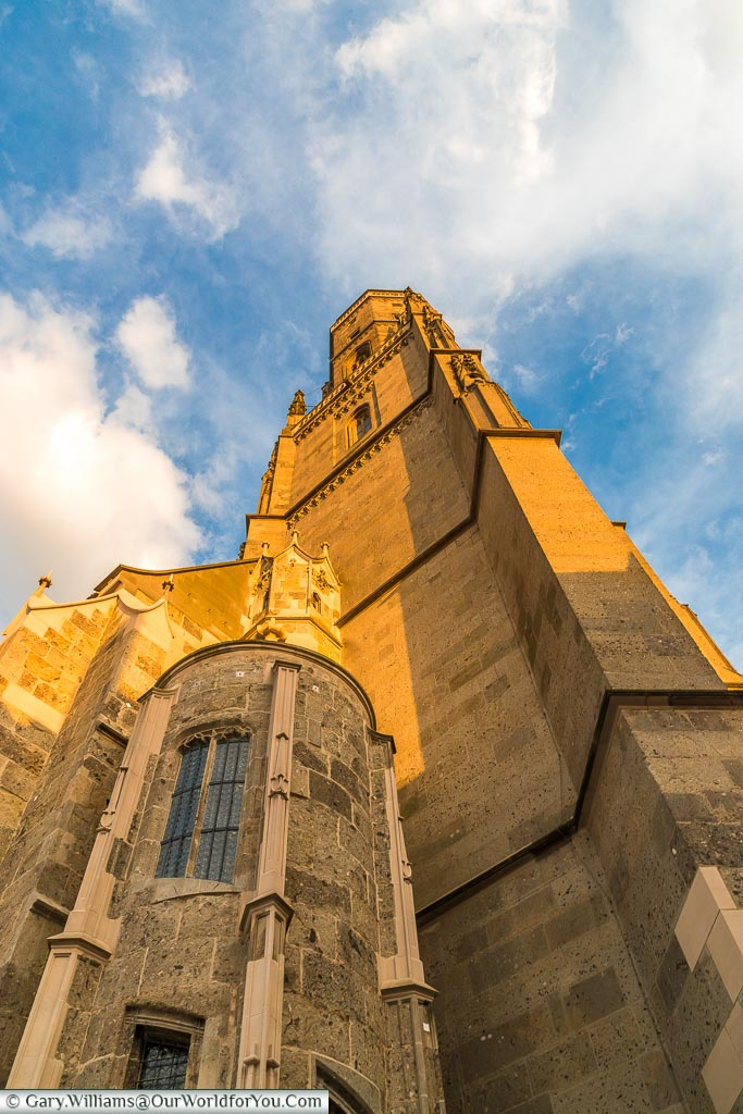 Looking up at the Daniel Tower of St George's Church caught in the golden light evening.