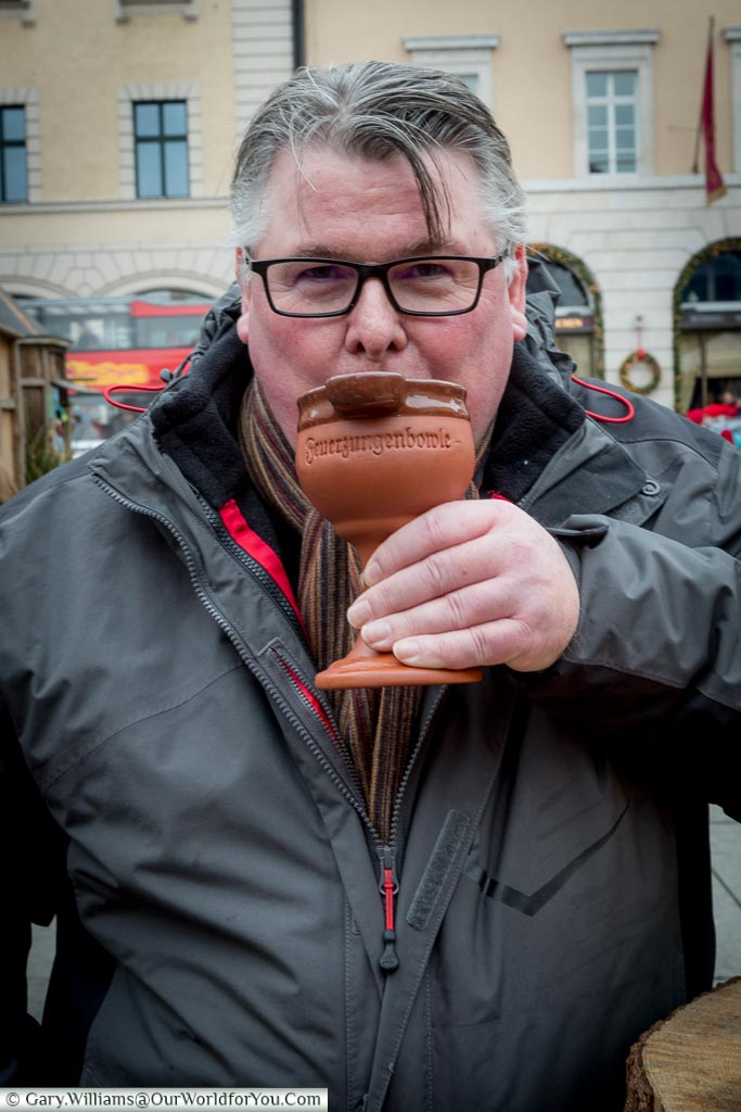 A shot of me, Gary, drinking gluhwein from a stone goblet at the medieval market in Munich.