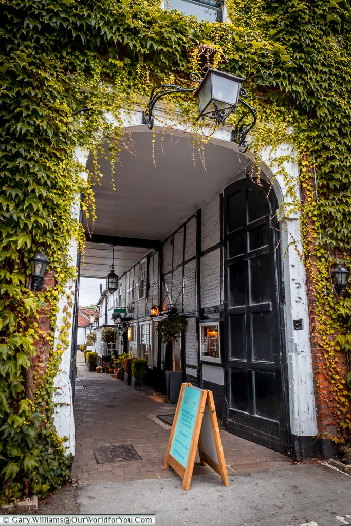 Through the ivy-covered  archway to the entrance courtyard of the Talbot Inn.