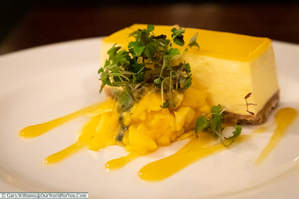 Janis's dessert of Mango and passionfruit cheesecake, with a coconut and mango salsa.