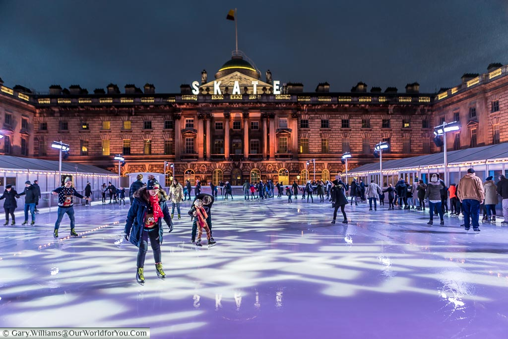 Skaters on the ice at London's Somerset house after the sun has gone down.