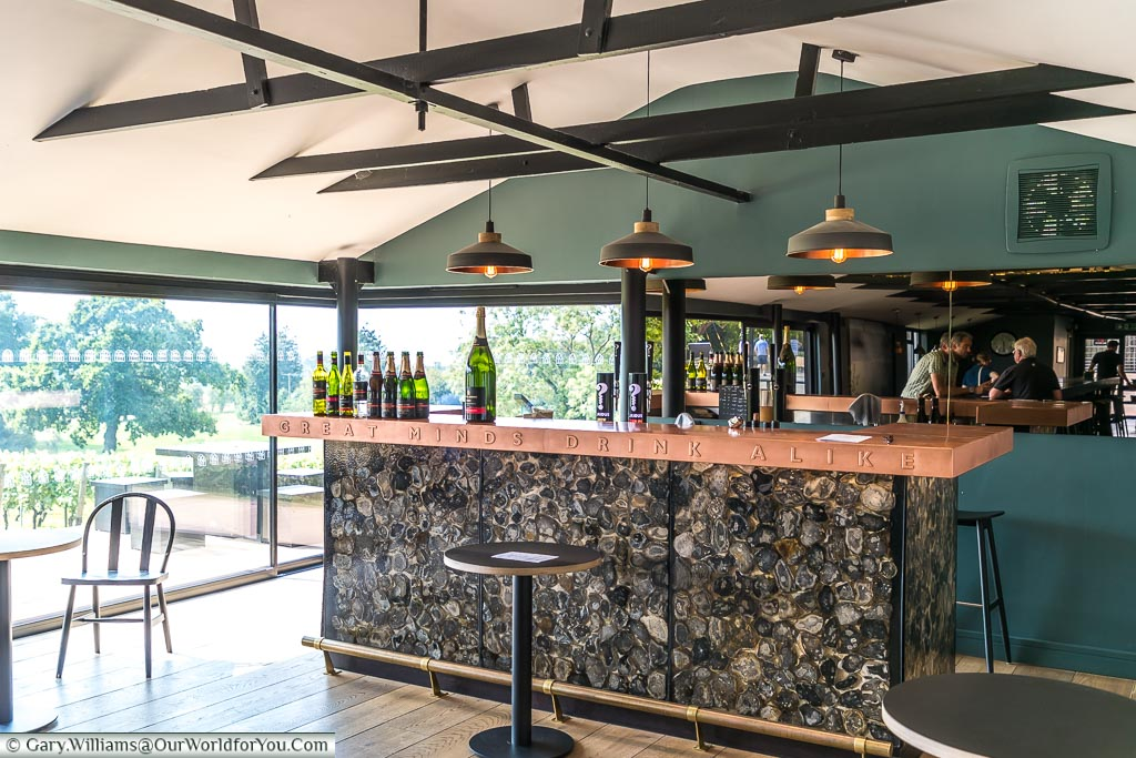 The copper-topped bar inside the Wine Sanctuary bearing the motif 'Great minds drink alike'.