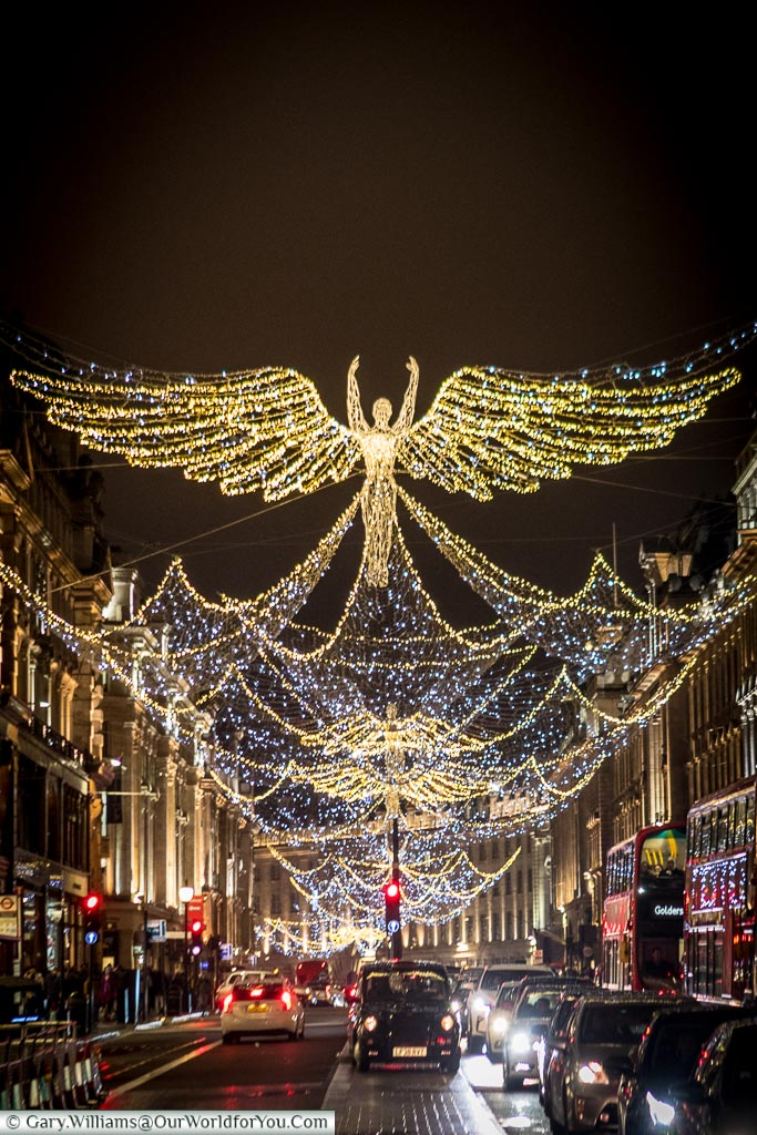 Illuminated Angels, with wings spread out, along London's Regent street.
