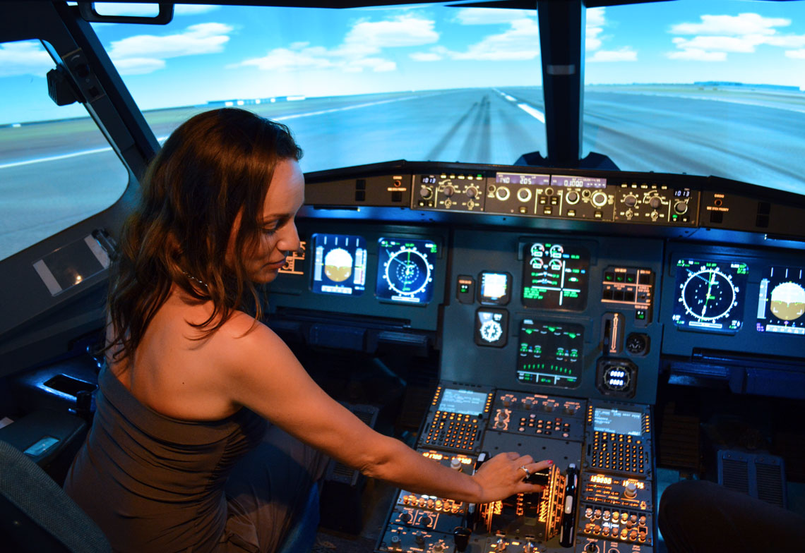 Flying the Flight Simulator in Singapore - Our World Travel Selfies