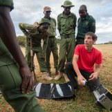 Alex's foundation, the Honnold Foundation, supports energy access projects around the world. In this photo, Alex is teaching Kenyan wildlife rangers how to use a GoalZero yeti, so that they can power radios, lights and phones on the go from their trucks. Photo: Ted Hesser