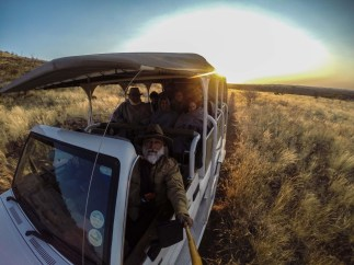 A make-shift bamboo monopod for an early morning, pre-rhino-tracking-safari-selfie.