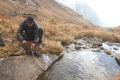 Filtering water from a stream somewhere in the Himalayan backcountry, photo by Anant Raina, The Outdoor Journal.