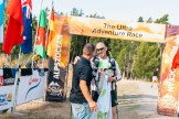 Alps 2 Ocean Ultra staff celebrate with Jim after he crossed the finish line in Oamaru. Photo by: Ryan Richardson