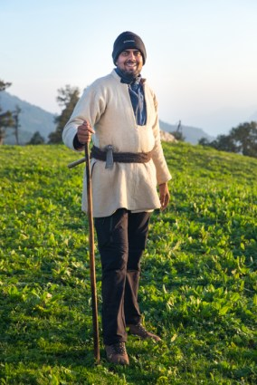 Anand Sankar, founder & manager of Kalap Tourism Project, and our guide for the trek shows off his Farzi, a big warm white coat made of goat wool. It has a rope made of goat hair tied around the waist as a belt, where one can stick equipment such as axe. A handy, warm outfit that saves lives. Photo Courtesy/ The Outdoor Journal
