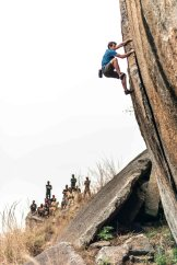Alex on-sight soloing a new route in Angola, Africa. The rock was a bit brittle at times, which made for an interesting solo... the route was 5'11+. Photo: Ted Hesser