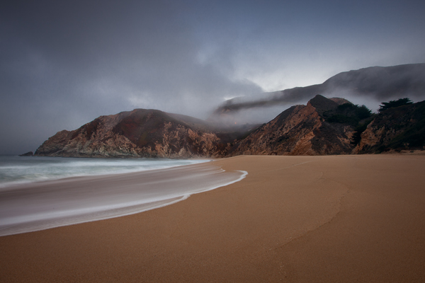 Photo of Grey Whale Cove in California after spots in sand and sky removed.