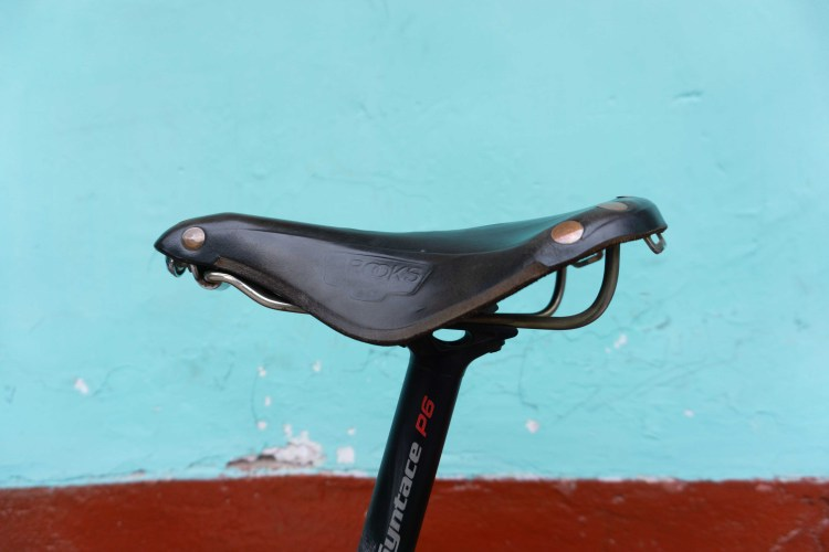 lower back pain from cycling because of saddle position too far forward horizontal