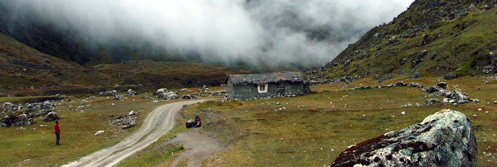 A lone hiker getting ready for a long trek in the Cordillera Real, Bolivia