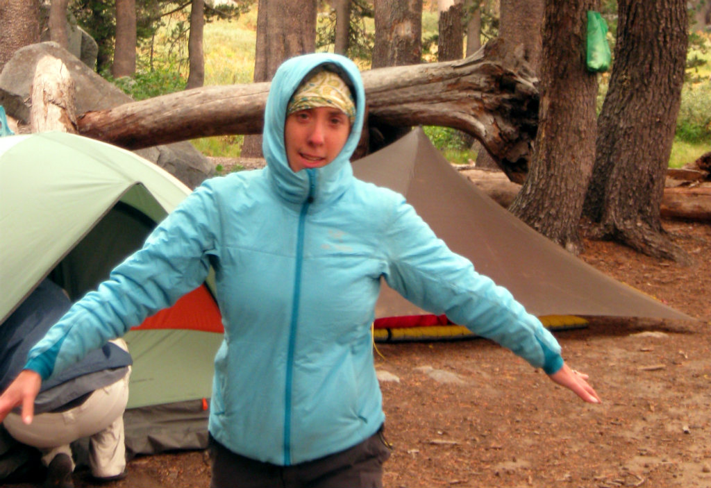 Mika celebrating the magic of her synthetic insulated jacket on a cold evening camping in Desolation Wilderness, California