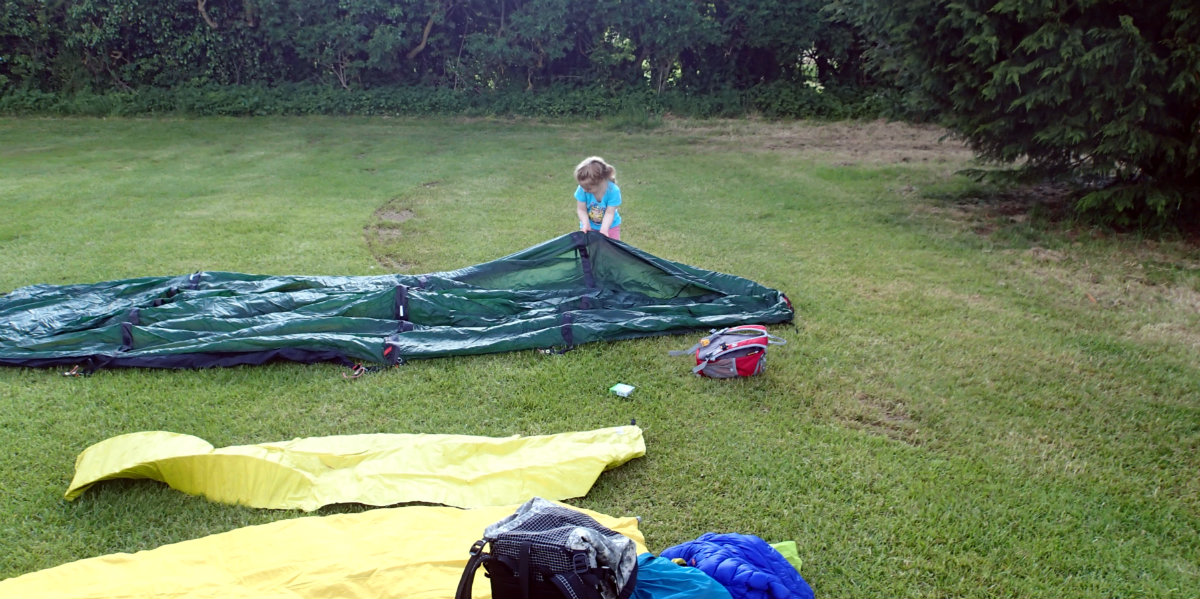 Setting up our tent with my little helper