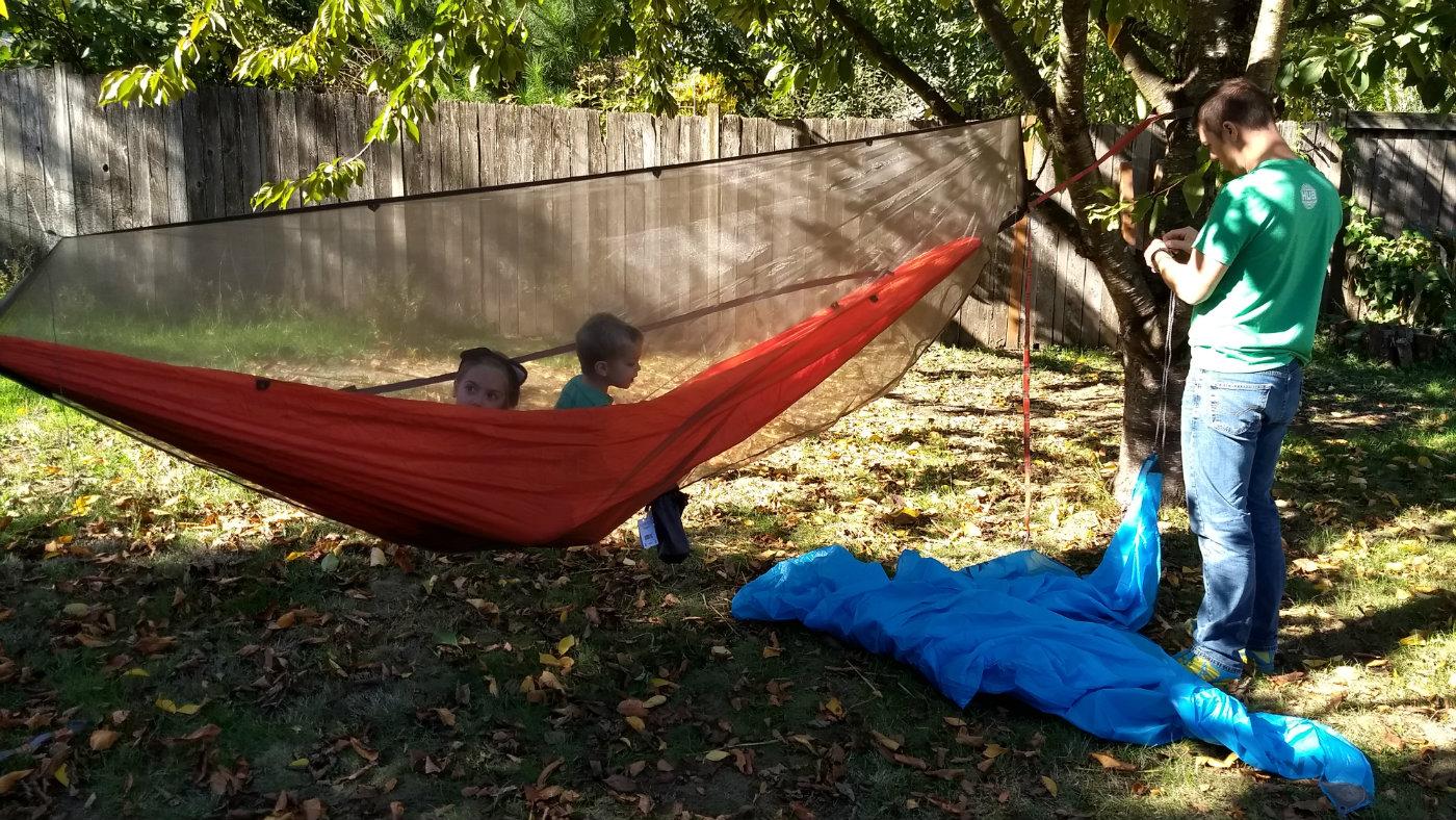 Testing a hammock setup in a garden