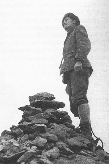 Albert Ellingwood on the summit of Lizard Head Peak in 1920