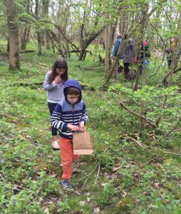 children walking through woodland
