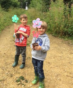 two boys holding butterfly feeders