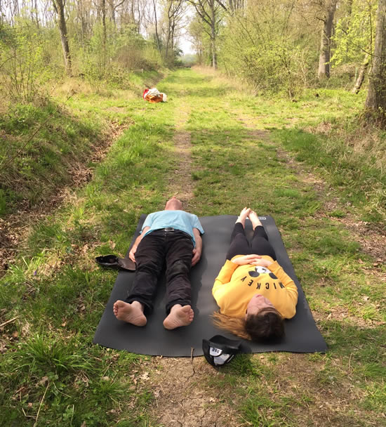 two people lying on the ground