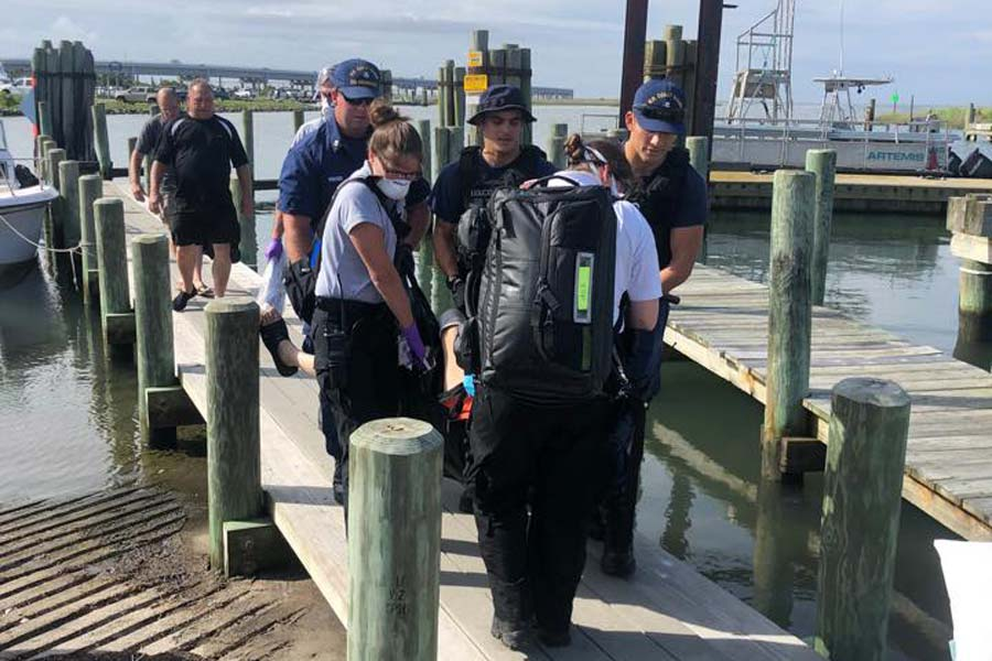Coast Guard, Dare EMS aid injured boater