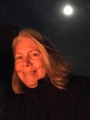 Joyce lit by campfire and moon at Mojave.