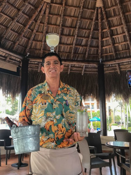 Ismael delivers happy hour drinks in style Mazatlan Mexico