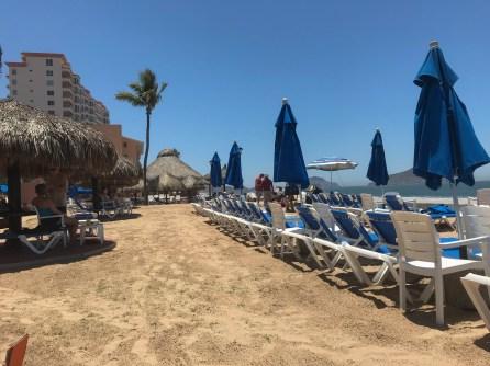 Palapas along the sea wall and vendors just setting up at Mazatlan Mexico