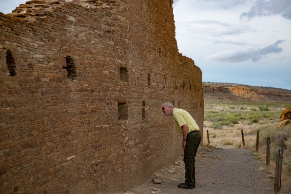 Bruce looks through a window at Chaco Canyon NHP