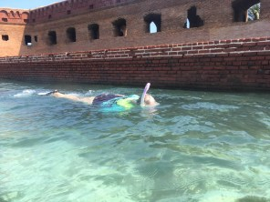 Joyce snorkeling next to the moat wall at Fort Jefferson