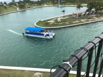 The tour pontoon boat departs Boca Chita with the picnic pavillion in the background