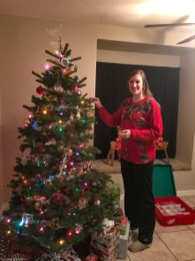 Megan decorating her tree