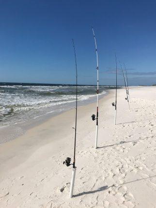 Multi-task fisherman on the Gulf beach at Fort Pickens, FL