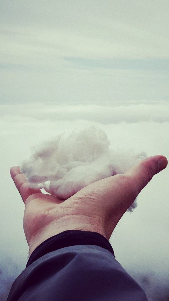 Man with a cloud in hand having transformed his past regrets with his mind