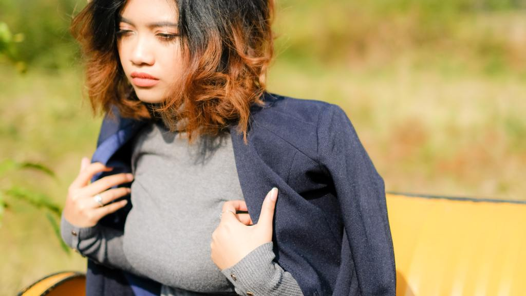 Woman putting jacket over her looking upset to show what is emotional intelligence