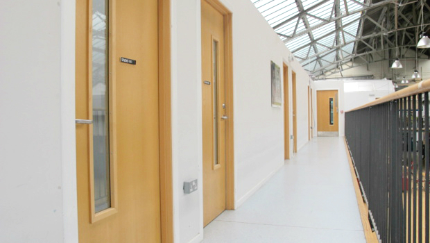 A tidy row of studio doors on the first floor of the Drill Hall.