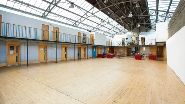 Wide-angle shot of the Drill Hall art studios, including studio space on the ground floor, first floor, exhibition hall and a cafe.