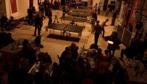 Competitors play table tennis at a Wiff Waff Wednesday event, whilst others eat food from the Drill Hall Arts Cafe.