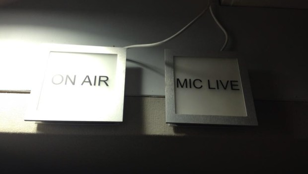 Signs above the recording studio flash 'On Air'.