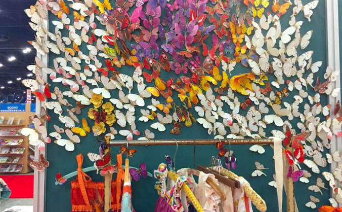 There is something about fabric art that makes my heart sing. I love the way talented artists and seamstresses (because I think sew-ers isn't a word) take fabric and make things you can actually wear, snuggle with or hang on a wall to be enjoyed for enjoyment's sake. Dana's quilt market wrap up was just the hit of beauty I needed this week. The colors, patterns and explosion of creativity just blew my mind. Dana's site is an amazing inspiration and resource for anyone who loves to sew, or wants to love to sew. She even inspired me to make a garland for my daughter's first bed - the isolette at the hospital - it was outrageously wonderful.