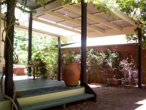 Skillion roof carport providing sheltered carspace and entrance area