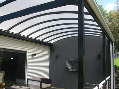A curved patio roof will add interest and style to your contemporary or modern house.