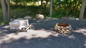 Old Fire Pit And Pallet With New Granite Blocks For Fire Pit