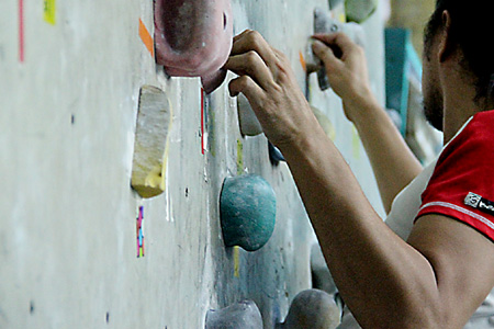 Gripping the handholds on a wall
