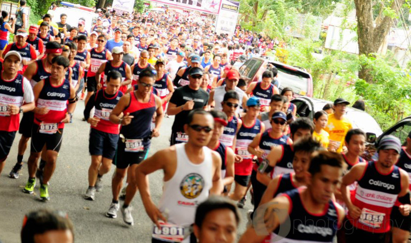 21k runners rush through the starting line of the Caliraya Uphill Challenge race