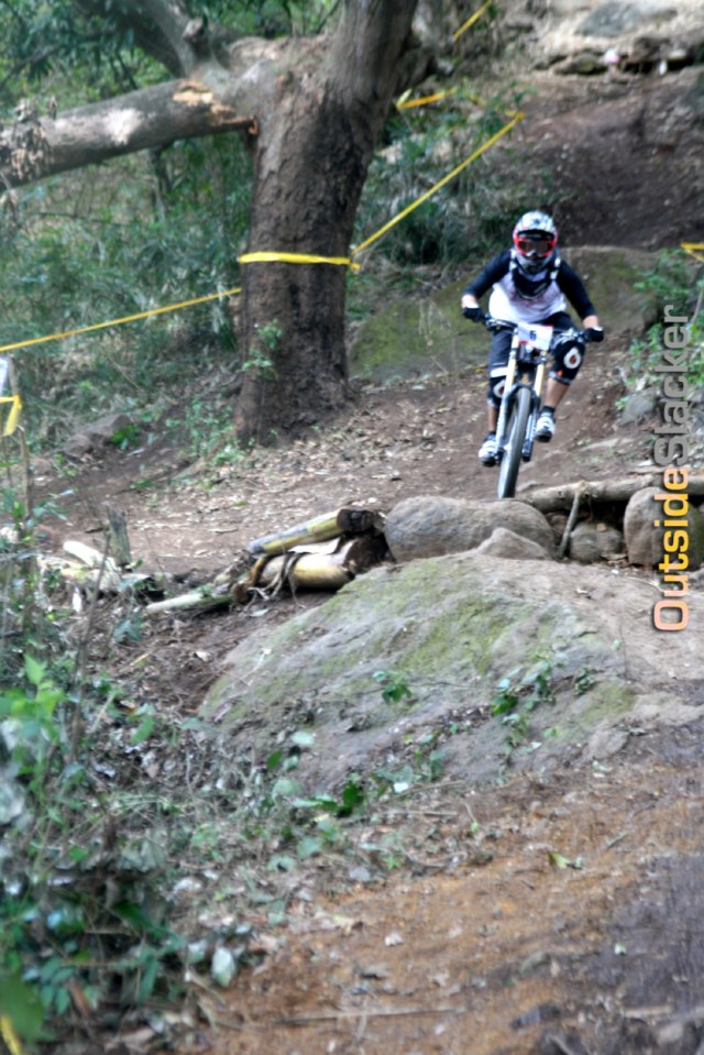 Downhill racer negotiates the steep slope