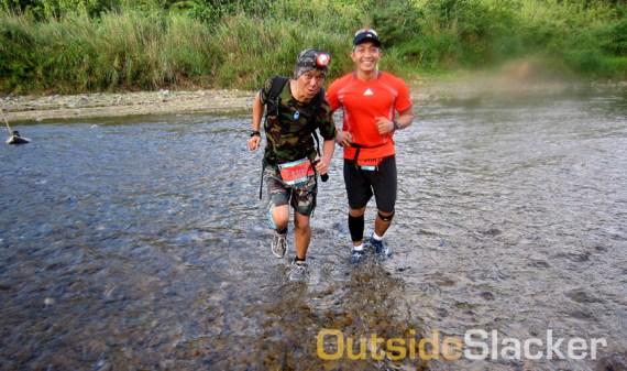 Trail runners negotiate a stream during the Love a Tree Ultramarathon